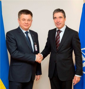 NATO Secretary General Anders Fogh Rasmussen signs an exchange of letters with Ukrainian Defense Minister Pavlo Lebedev