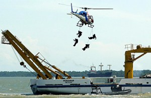 Malaysian special forces abseil onto a vessel from a police helicopter during an antipiracy demonstration in the Strait of Malacca (Jimin Lai / AFP)