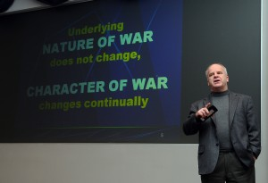 Marine Corps Col. (ret.) T.X. Hammes speaks to USTRANSCOM workers about the evolution of war.