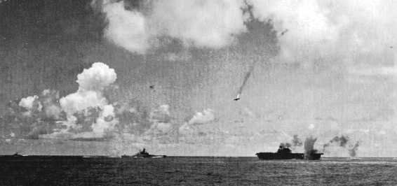 "A Japanese ""Val"" Dive-Bomber is shot down over the USS Enterprise on October 26, 1942 during the Battle of Santa Cruz (Wikimedia Commons)"