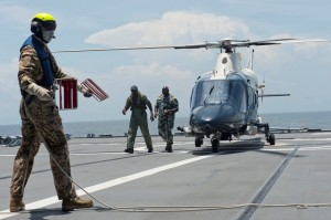 (April 20, 2014) – Nigerian Navy Rear Adm. S. I. Alade, flag officer commanding Western Naval Command, arrives by helicopter to the German ship FGS Bonn (A-1413) during Obangame Express 2014. (U.S. Navy photo by Mass Communication Specialist 2nd Class John Herman/Released)