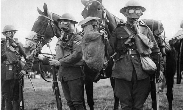 horses-and-men-in-gas-masks-during-tests-to-find-the-best-protection-against-gas-attacks-pic-dm-965360765