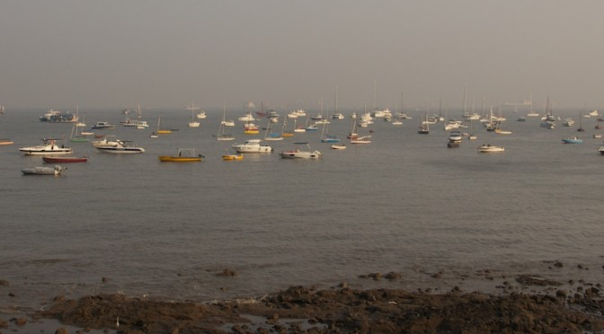 A crowded waterfront in Mumbai.