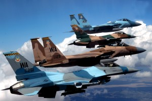 A flight of Aggressor F-15 Eagles and F-16 Fighting Falcons fly in formation. The jets are assigned to the 64th and 65th Aggressor squadrons at Nellis Air Force Base.