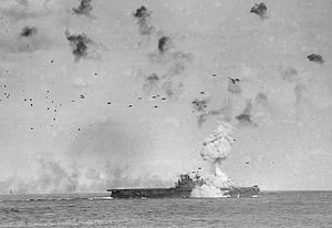A kamikaze attack on USS Enterprise. Swarm attacks were used by the Japanese Imperial forces in the closing stages of World War II to inflict heavy casualties in the Pacific theatre.