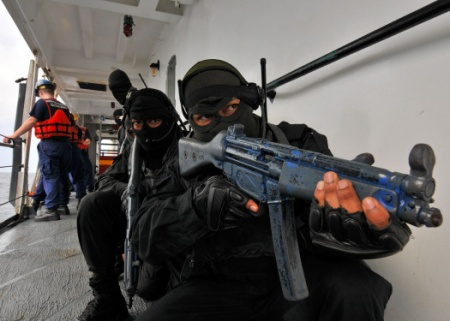 Royal Malaysian Navy sailors stand security watch during a boarding exercise aboard the U.S. Coast Guard cutter Mellon as part of Southeast Asia Cooperation Against Terrorism 2010. SEACAT is a weeklong at-sea exercise designed to highlight the value of information sharing and multinational coordination.