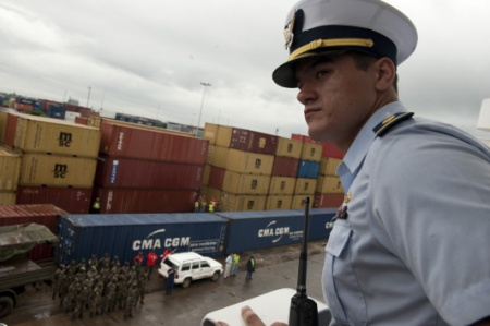 .S. Coast Guard Ensign looks for safety hazards from aboard the Coast Guard Cutter Forward's bridge as the ship docks at the pier in Monrovia, Liberia, during an international mission in support of the Africa Partnership Station (APS) June 17, 2011.