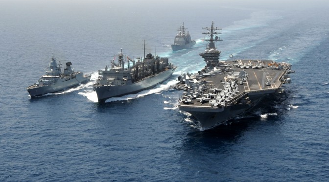 The German navy frigate FGS Hamburg (F220), left, and the aircraft carrier USS Dwight D. Eisenhower (CVN 69), right, take on fuel and stores from the Military Sealift Command fast combat support ship USNS Bridge (T-AOE 10), center, during a replenishment-at-sea in the Arabian Sea on March 23, 2013. The Eisenhower, Hamburg and USS Hue City (CG 66), top, are deployed to the 5th Fleet area of responsibility to conduct maritime security operations and theater security cooperation efforts.