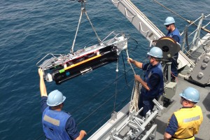 USN sailors load a SeaFox MCM UUV (U.S. Navy photo by Lt. Colby Drake/Released)