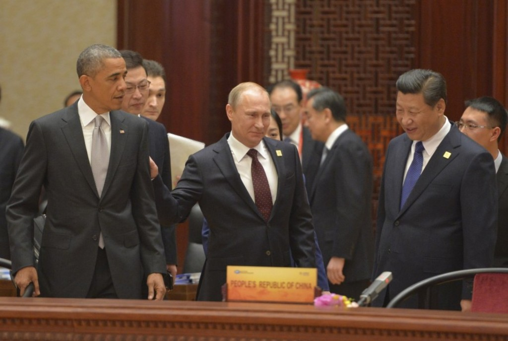 U.S. President Obama, Russian President Vladimir Putin and Chinese President Xi Jinping attend a plenary session during the Asia Pacific Economic Cooperation Summit in Beijing, Reuters.