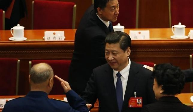 Xu Qiliang (L), vice Chairman of China's Central Military Commission, salutes China's President Xi Jinping (C) during the closing ceremony of the Chinese National People's Congress (NPC) at the Great Hall of the People, in Beijing, March 13, 2014. REUTERS/Kim Kyung-Hoon