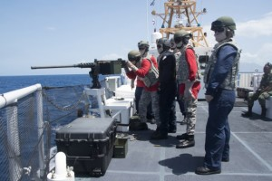 Members of the Dominican Navy participate in .50 cal exercises aboard a USCG Cutter. (Source: USCG)