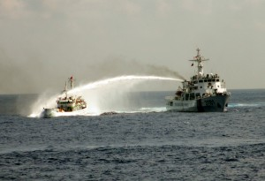 A Chinese Coast Guard Ship fires water cannons at a Vietnamese Vessel in 2014.