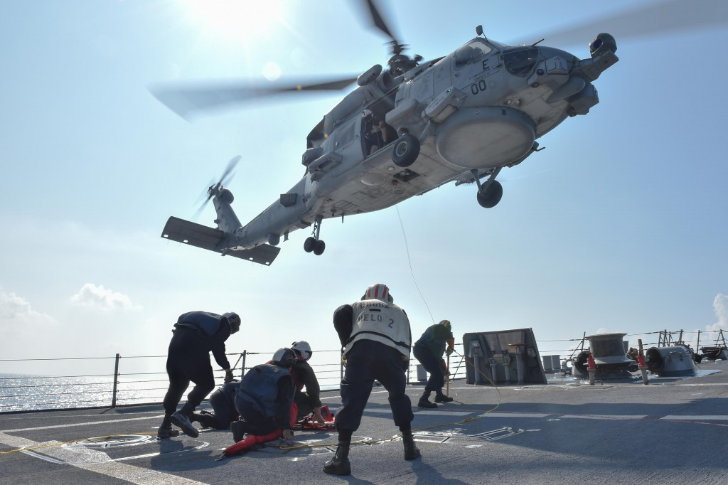 USS Lassen's crew carries out a medical training exercise with an airborne MH-60R Seahawk helicopter in the South China Sea some time before the FONOP. (credit: Navy.mil) -Had this been done within 12 NM of Subi Reef, America's commitment to Freedom of Navigation would be unambiguous.