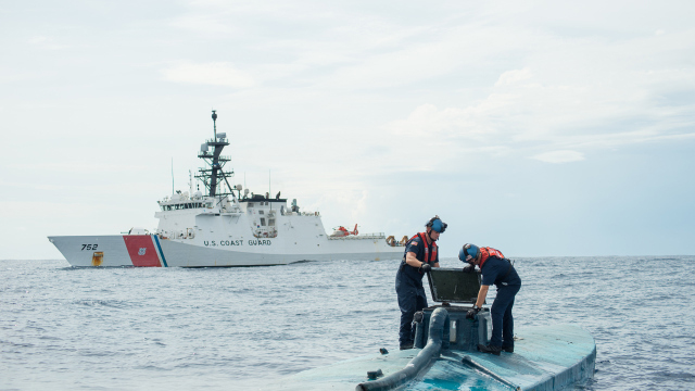 A Coast Guard Cutter Stratton boarding team seizes cocaine bales from a self-propelled semi-submersible interdicted in international waters off the coast of Central America, July 19, 2015. The Coast Guard recovered more than 6 tons of cocaine from the 40-foot vessel. (Coast Guard photo courtesy of Petty Officer 2nd Class LaNola Stone)