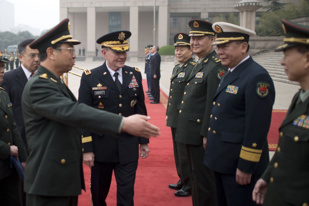 General Fang Fenghui (left), chief of the General Staff of the People's Liberation Army, introduces General Martin Dempsey (center), chairman of the U.S. Joint Chiefs of Staff, to Chinese military officials in Beijing on April 20, 2013. (Photo credit: D. Myles Cullen/Defense Department)