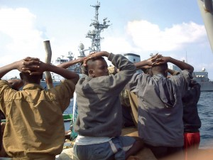 This photo taken Sunday, Jan. 4, 2009 provided by French Defense Minister shows suspected pirates arrested by Marine commandos of the French Navy in the Gulf of Aden, off Somalia coasts. French government officials say the Jean de Vienne intercepted and captured 19 pirates Sunday as they tried to take over two cargo ships, one Croatian and the other Panamian. French Navy vessel Jean de Vienne is seen on background. (AP Photo/French Navy/French Defense Minister/HO)