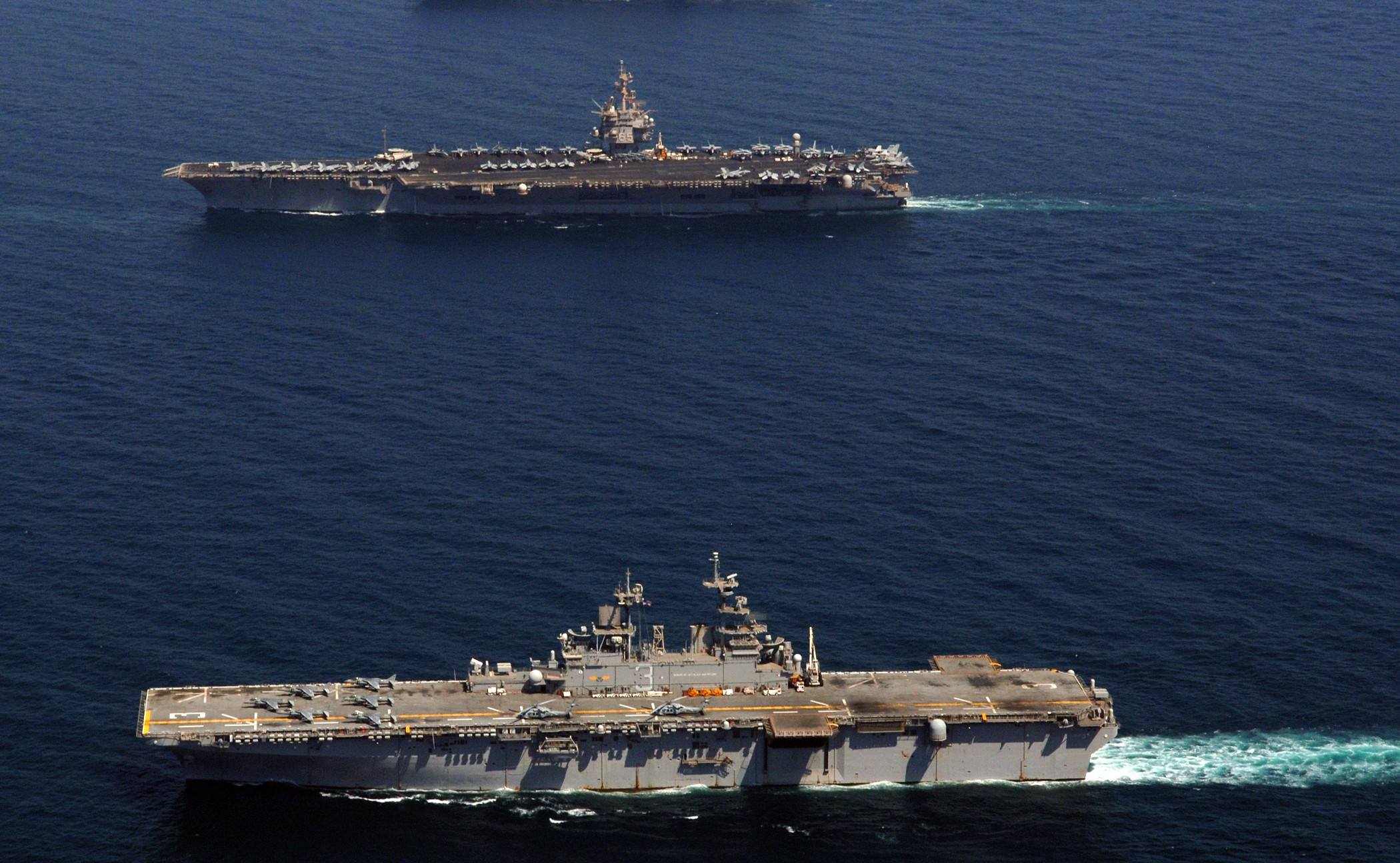 070928-N-5928K-011 PERSIAN GULF (Sept. 28, 2007) - Nuclear-powered aircraft carrier USS Enterprise (CVN 65) and amphibious assault ship USS Kearsarge (LHD 3) and USS Bonhomme Richard (LHD 6) transit alongside each other in the Persian Gulf. Enterprise and embarked Carrier Air Wing (CVW) 1 are underway on a scheduled deployment. U.S. Navy photo by Mass Communication Specialist 3rd Class N.C. Kaylor (RELEASED)