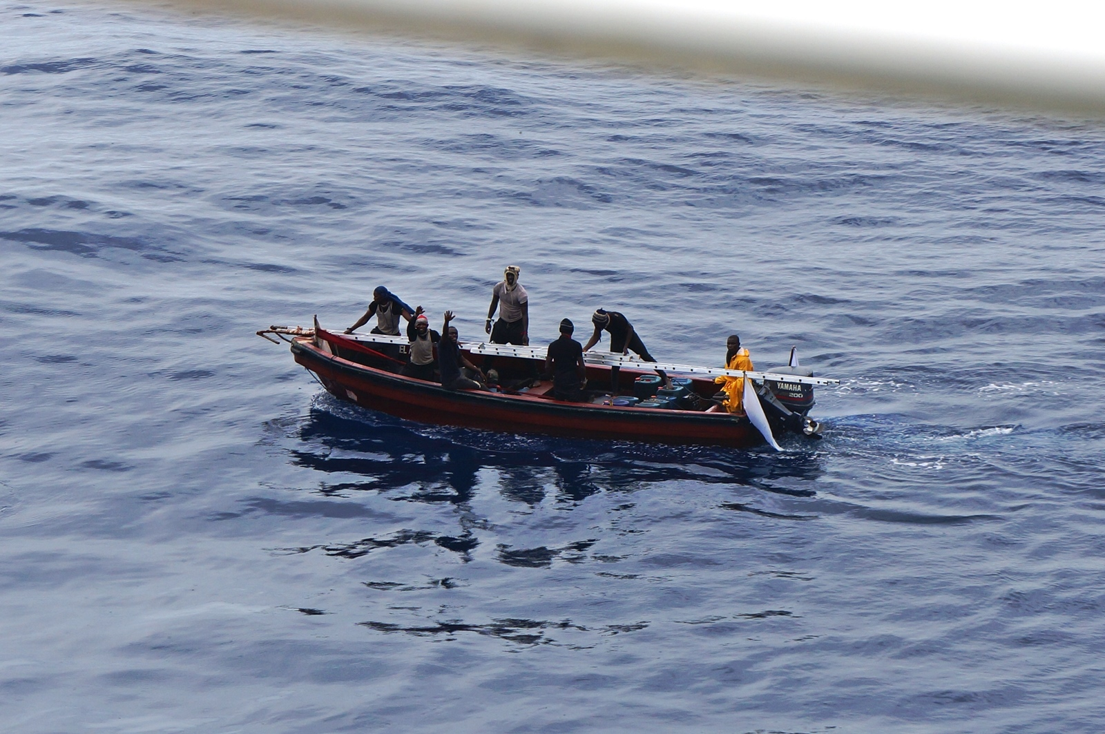 "Nigerian pirates taunting the crew of a tanker in the Agbami oil field in broad daylight in April 2016. Note the 200 hp main outboard engine and white ""battle"" flag traditionally used by the Movement for the Emancipation of the Niger Delta (2006-9)."