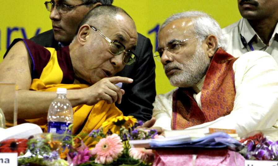 The Dalai Lama, left, speaks with the former Gujarat state Chief Minister Narendra Modi during an international seminar on Buddhist Heritage in Vadodara, south of Ahmadabad, India, Friday, Jan.15, 2010.