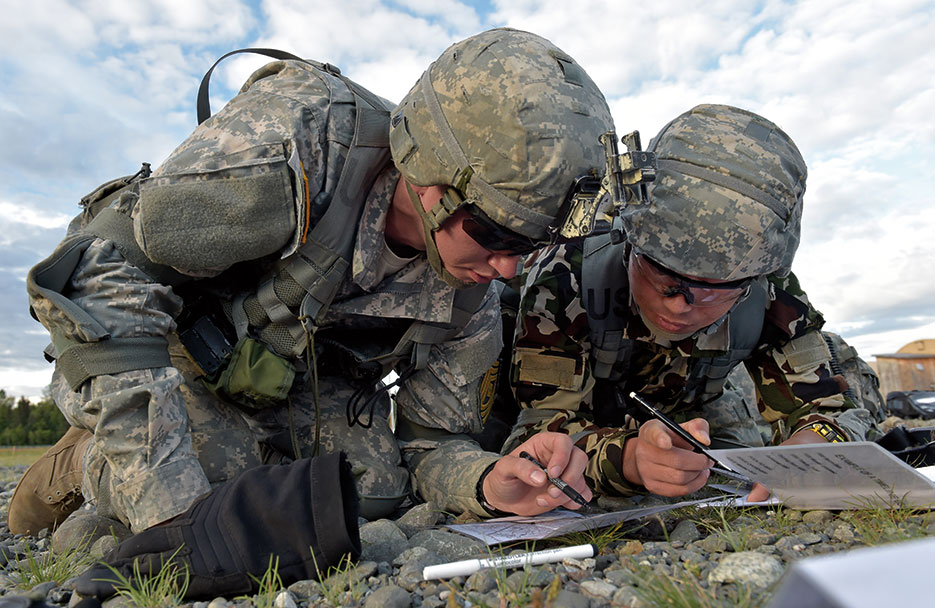 Nepalese army ranger works with U.S. Army Soldier during Situational Training Exercise portion of U.S. Army Alaska Warrior Leader Course on Joint Base Elmendorf-Richardson, August 2015 (U.S. Air Force/Justin Connaher)