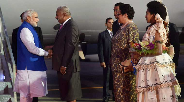 Prime Minister Narendra Modi being welcomed by his Fijian counterpart Josaia Voreqe Bainimarama at Nausori International Airport as he arrives in Fiji on Wednesday. (PTI Photo)