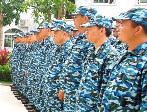 Tanmen Maritime Militia Company personnel wearing blue uniforms in 2014.