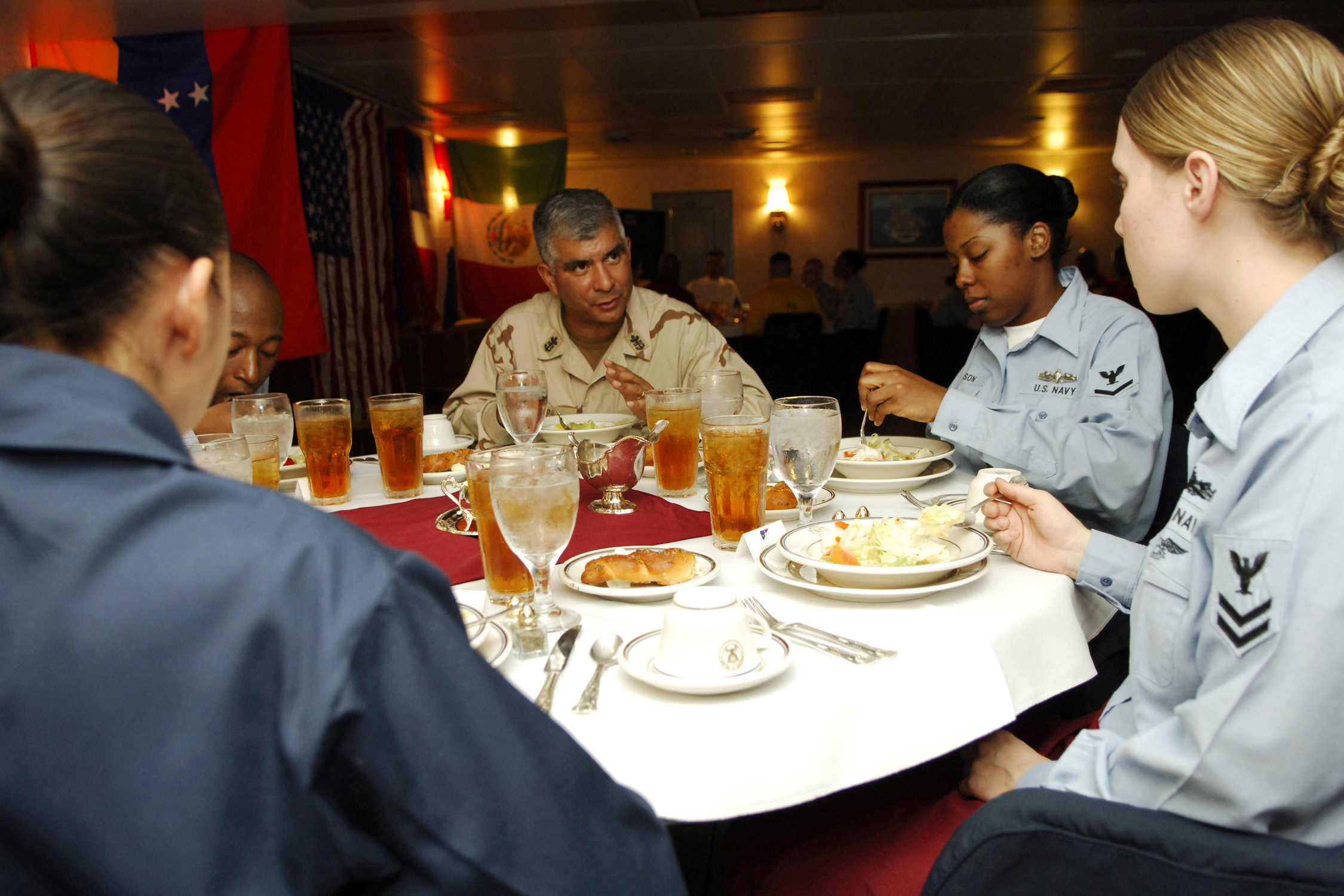 071029-N-1598C-028 PERSIAN GULF (Oct. 29, 2007) - Master Chief Petty Officer of the Navy (MCPON) Joe R. Campa Jr. enjoys a formal dinner in the wardroom with junior Sailors aboard nuclear-powered aircraft carrier USS Enterprise (CVN 65). MCPON and Chief of Naval Operations (CNO) Adm. Gary Roughead are visiting Sailors in the 5th Fleet area of responsibility. Enterprise and embarked Carrier Air Wing (CVW) 1 are underway on a scheduled deployment. U.S. Navy photo by Mass Communication Specialist 3rd Class McKinley Cartwright (RELEASED)