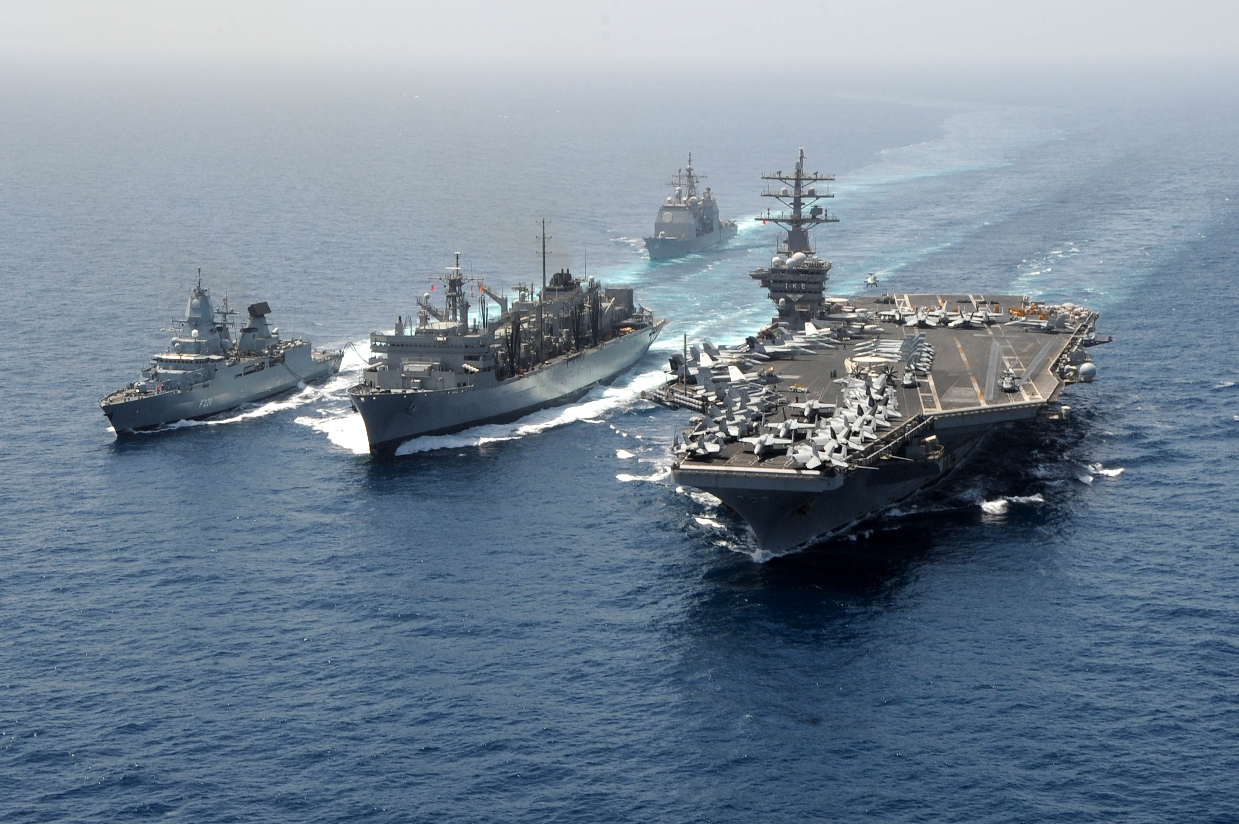 The German Navy frigate FGS Hamburg (F220), left, and the aircraft carrier USS Dwight D. Eisenhower (CVN 69), right, take on fuel and stores from the Military Sealift Command fast combat support ship USNS Bridge (T-AOE 10), center, during a replenishment-at-sea in the Arabian Sea on March 23, 2013. (U.S. Navy photo by Mass Communication Specialist 2nd Class Ryan D. McLearnon/Released)