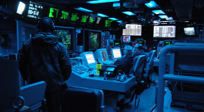 Sailors stand watch in the Combat Direction Center (CDC) USS ABRAHAM  LINCOLN (CVN 72) monitoring the operating area in March 2003. Credit: PMAN Tiffany Aiken/ U.S. Navy