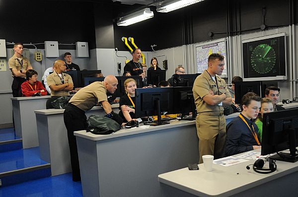 160123-N-PU674-018 PENSACOLA, Fla. (Jan. 23, 2016) Information warfare Sailors from the Center for Information Dominance Unit Corry Station mentor high school students during CyberThon, an event designed to develop the future cybersecurity workforce. Hosted by the Blue Angels Chapter of the Armed Forces Communications and Electronics Association, CyberThon challenged the students to play the role of newly hired information technology professionals tasked with defending their company's network. (U.S. Navy photo by Carla M. McCarthy/Released)