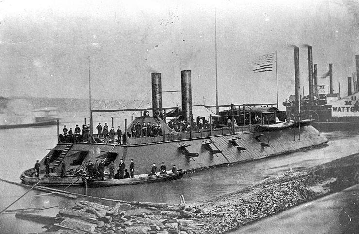 USS Cairo 1862 Photographed in the Mississippi River area during 1862, with a boat alongside her port bow, crewmen on deck and other river steamers in the background. (U.S. Naval Historical Center)