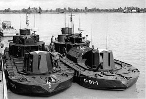 "Two Vietnam-era ""Monitor"" riverine craft. The vessel at right has been modified to support C2 functions by replacing the mortar pit with a communications center. (Doug Lindsey via Rivervet.com)"