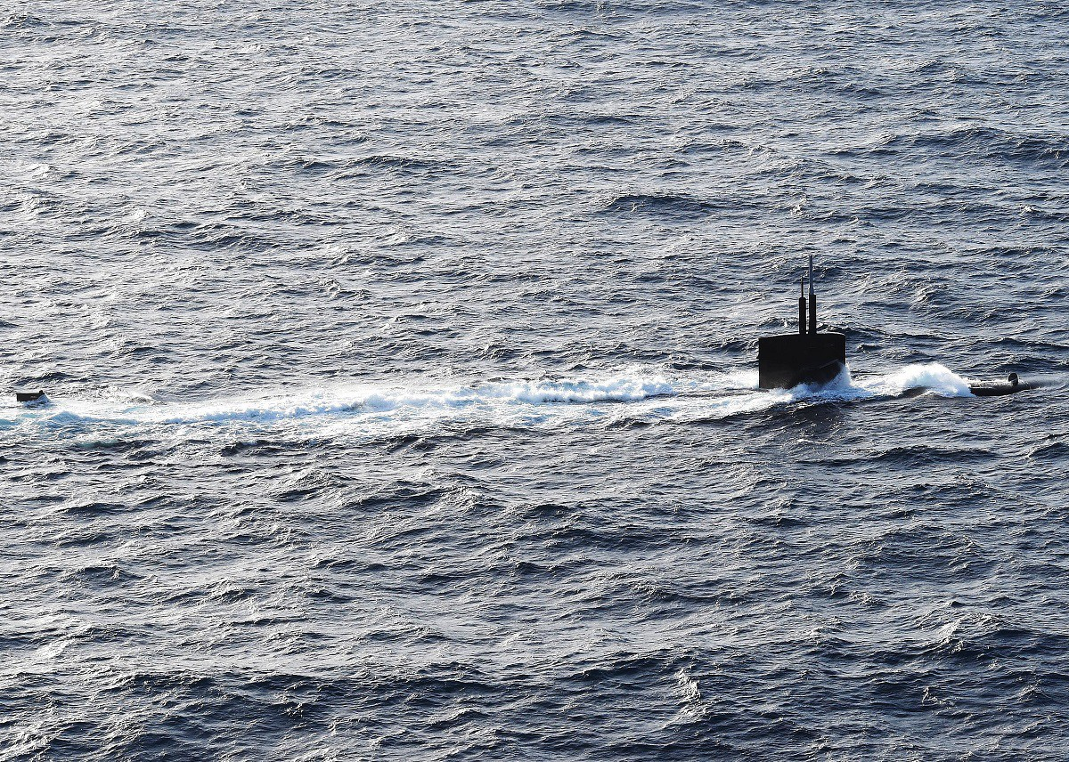 160324-N-QY430-523 ATLANTIC OCEAN (March 24, 2016) The Los Angeles-class attack submarine USS Helena (SSN 725) transits the Atlantic Ocean with the USS Dwight D. Eisenhower (CVN 69), the flagship of the Eisenhower Carrier Strike Group. Ike is underway conducting a Composite Training Unit Exercise (COMPTUEX) with the Eisenhower Carrier Strike Group in preparation for a future deployment. (U.S. Navy photo by Mass Communication Specialist 1st Class Rafael Martie/Released)