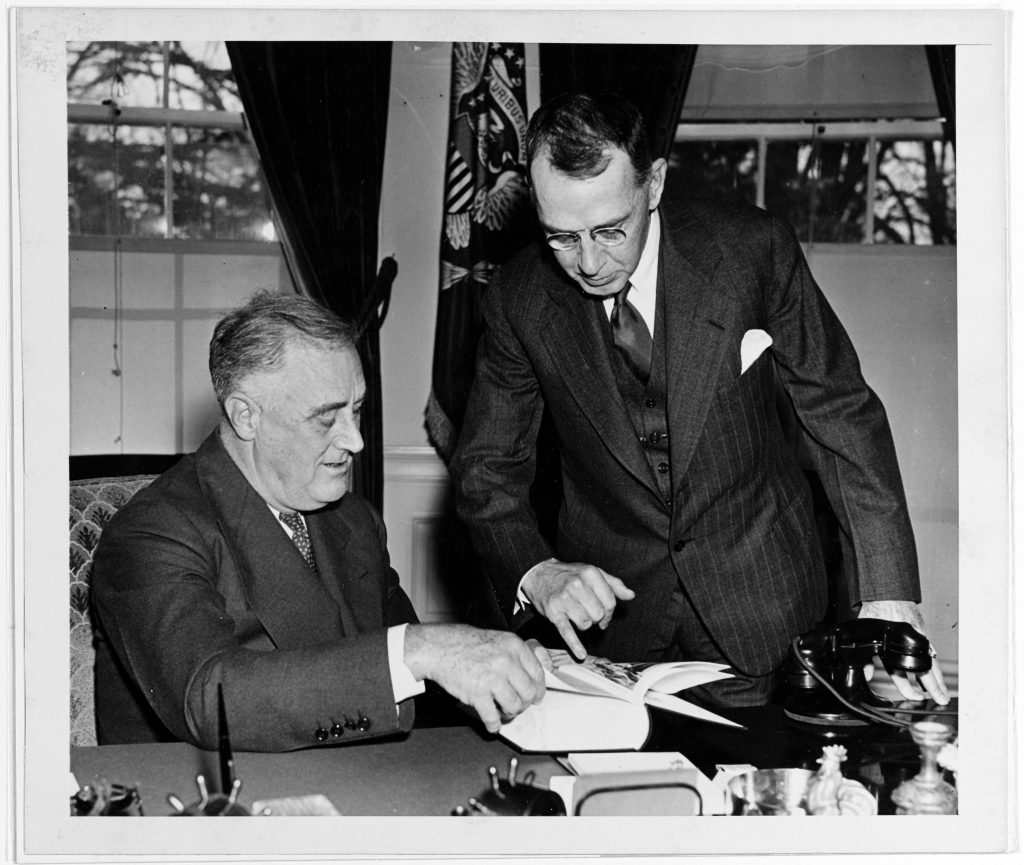 "Retired Captain Dudley W. Knox presents President Franklin D. Roosevelt with the final volume of an edited collection official naval records relating to U.S. Navy strategy and operations during the undeclared War with France between 1798 and 1801. After four years work, Roosevelt and Knox worked together to complete these volumes by 1938. Roosevelt insisted upon referring to the ""Quasi-War"" with France, much to the chagrin of Knox. However, Roosevelt specifically chose this phrase for the title of the work, as the underlying point of the work centered upon how he intended to employ the U.S. Navy in support of American neutrality strategy before the Second World War. Together, Roosevelt and Knox used history to inform American naval strategy in both peace and war."
