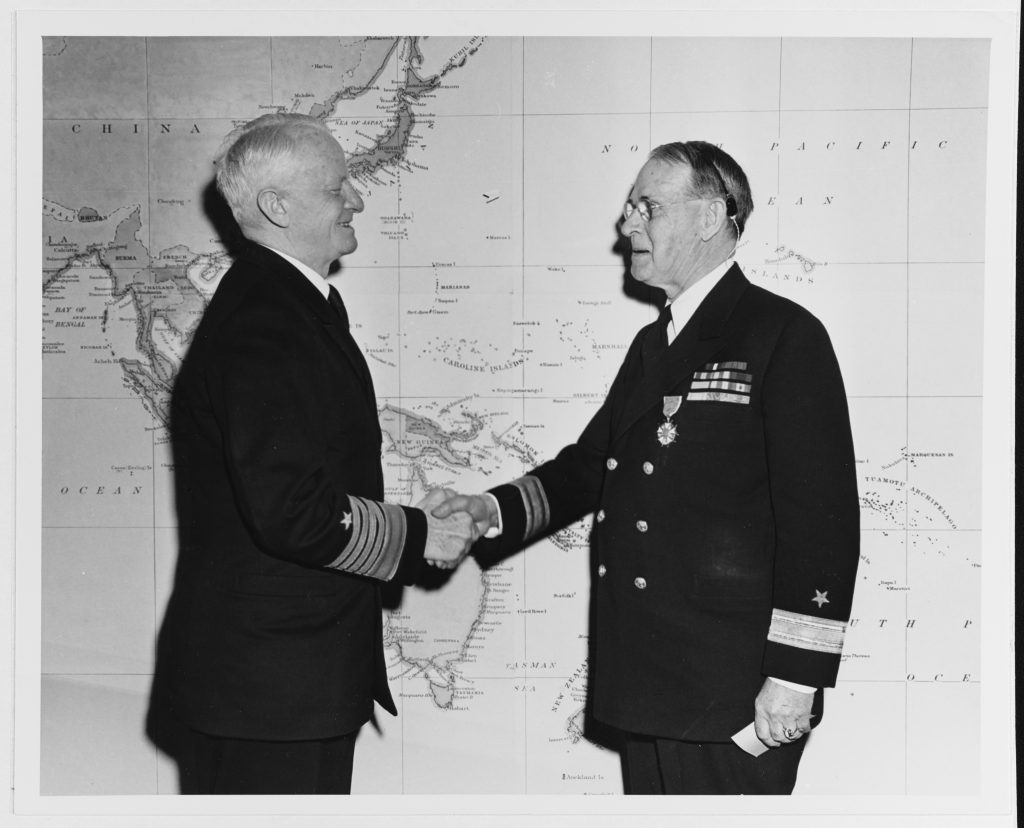 Fleet Admiral Chester W. Nimitz congratulating Commodore Dudley W. Knox with a Legion of Merit in 1946. During the Second World War, Knox returned to active status with assignment to the staff of the Chief of Naval Operations and Commander in Chief, U.S. Navy (CominCh). In this capacity, Knox served at large as a strategic adviser to President Franklin D. Roosevelt and Fleet Admiral Ernest J. King. Through their good offices, Knox established the Office of Naval History as a coequal branch of the Office of Naval Intelligence on the Operations Navy (OpNav) staff. For this service, King nominated Knox for promotion to commodore in 1945. The following year, the postwar Chief of Naval Operations, Nimitz, recognized Knox with the Legion of Merit Medal to mark his return to retired status. Nevertheless, Knox continued working within the Office of Naval History until his death in 1960.
