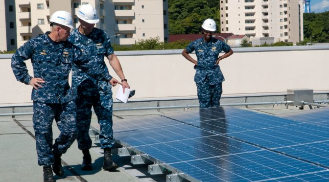 120822-N-ER662-031  YOKOSUKA, Japan (Aug. 22, 2012) Capt. David Owen, left, commanding officer of Fleet Activities Yokosuka, inspects recently installed solar panels at Sullivan Elementary School. The solar panels are a building integrated photovoltaic system, which is estimated to contribute $297,000 in projected annual energy savings at the installation. (U.S. Navy photo by Mass Communication Specialist 2nd Matthew R. Cole/Released)
